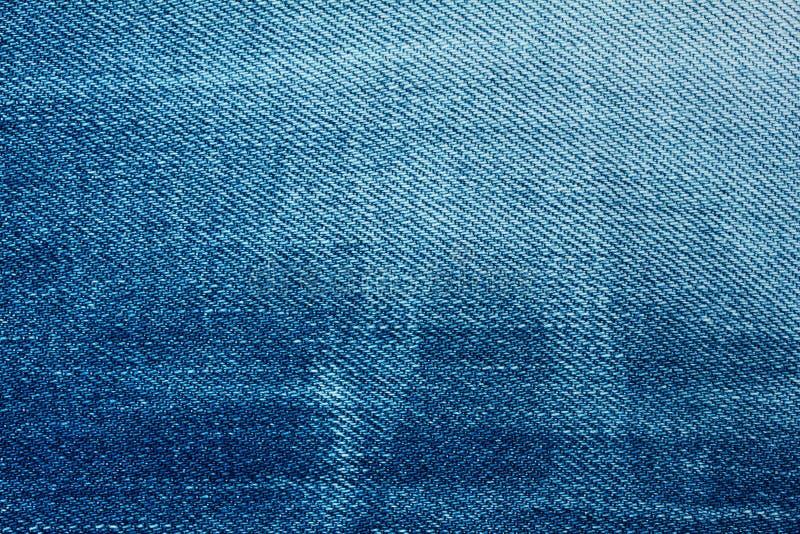 Blå grov bomullstvillbakgrund arkivfoto