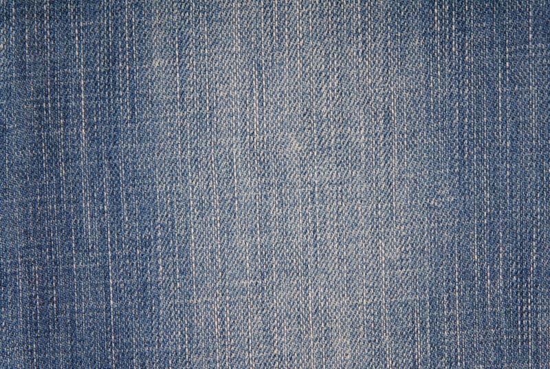 Blå grov bomullstvillbakgrund, jeanstyg, royaltyfria bilder