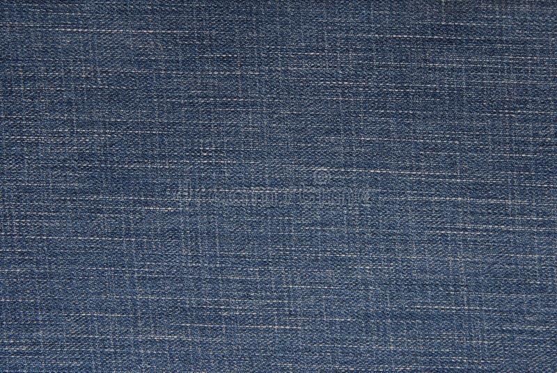 Blå grov bomullstvillbakgrund, jeanstyg, royaltyfri bild