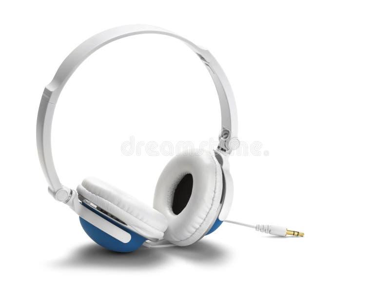 blå hörlurar royaltyfri foto