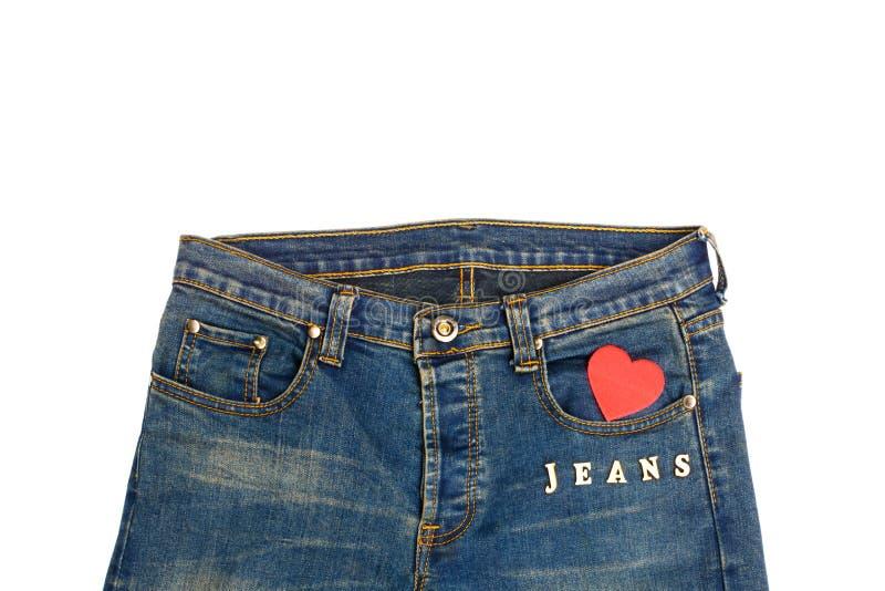 Blå jean med hjärtaform royaltyfri foto