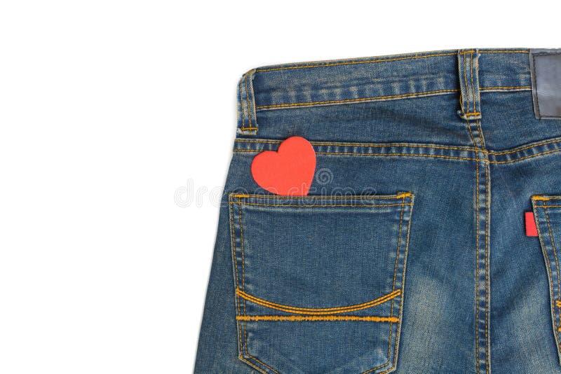 Blå jean med hjärtaform royaltyfri bild