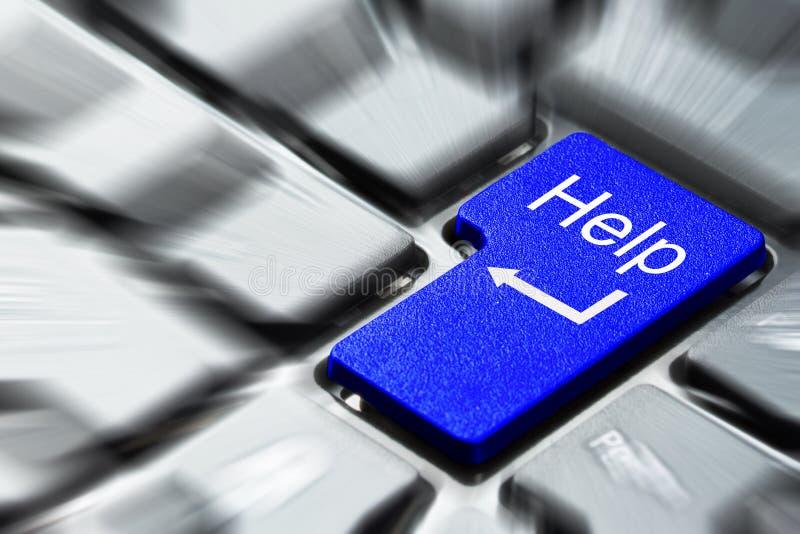 blå knapphjälp royaltyfri foto