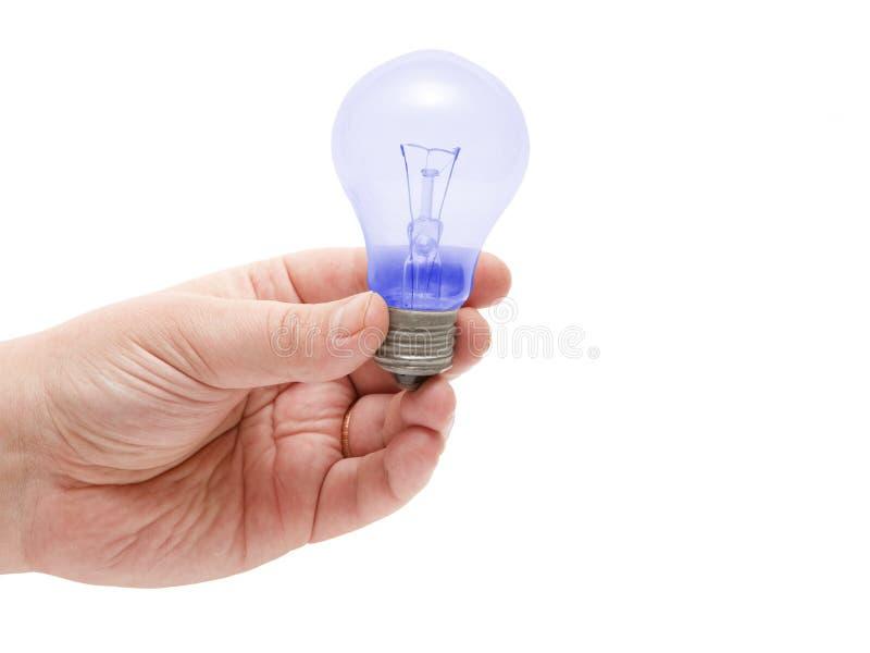 Blå lampa som ligger på den mänskliga handen arkivbild