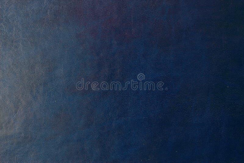 Blå mörk läderbakgrund eller textur royaltyfria bilder