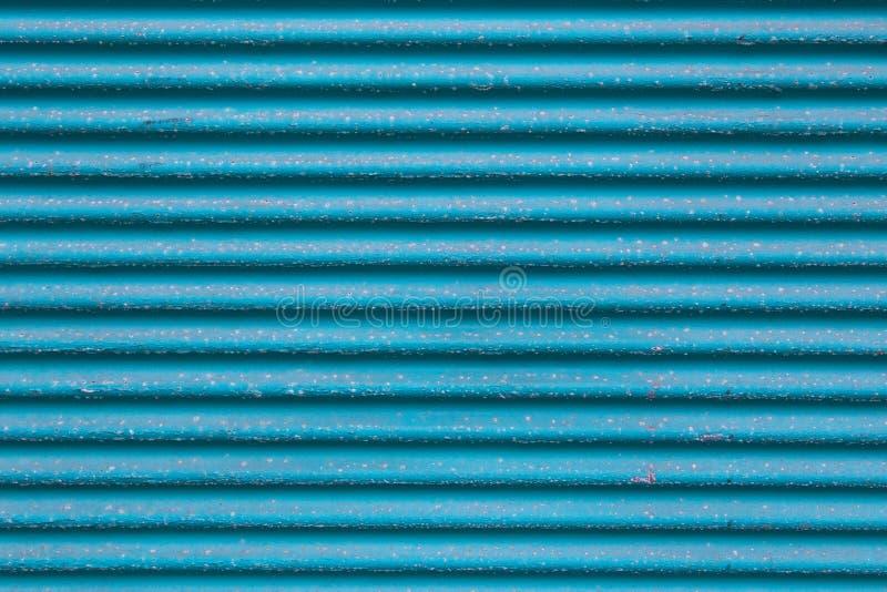 Blå metall korrugerade - stiga ombord bakgrund för texturturkosfärg arkivfoto