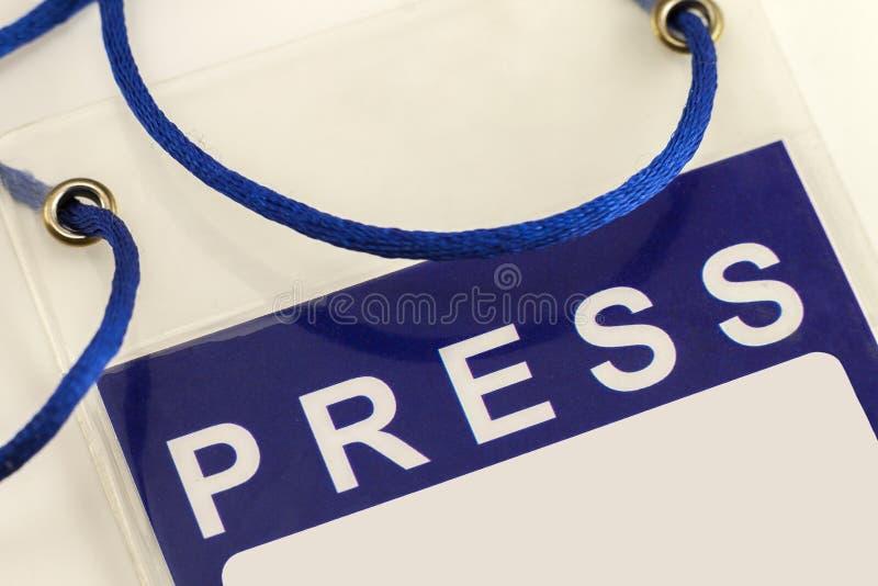 Blå närbild för kort för legitimation för presspasserande fotografering för bildbyråer