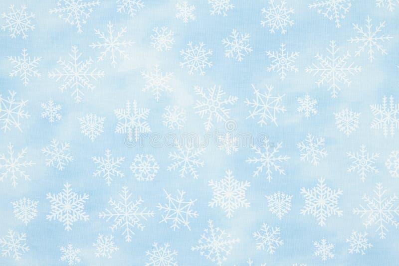 Blå och vit snöflingvinter eller julbakgrund arkivfoton