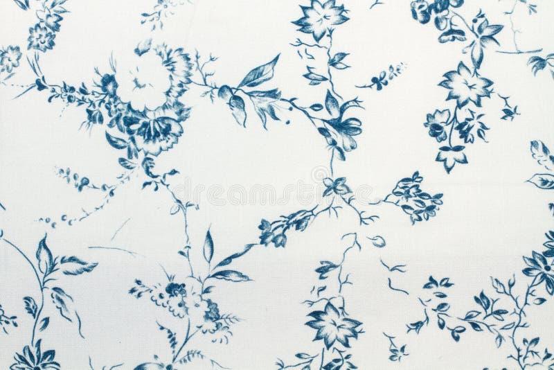 Blå pappers- textur för blommor och för sidor royaltyfri foto