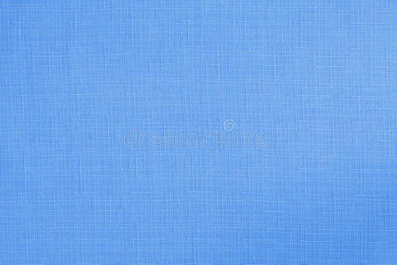Blå pastellfärgad bakgrund för textur för bomullstyg, sömlös modell av den naturliga textilen arkivbilder
