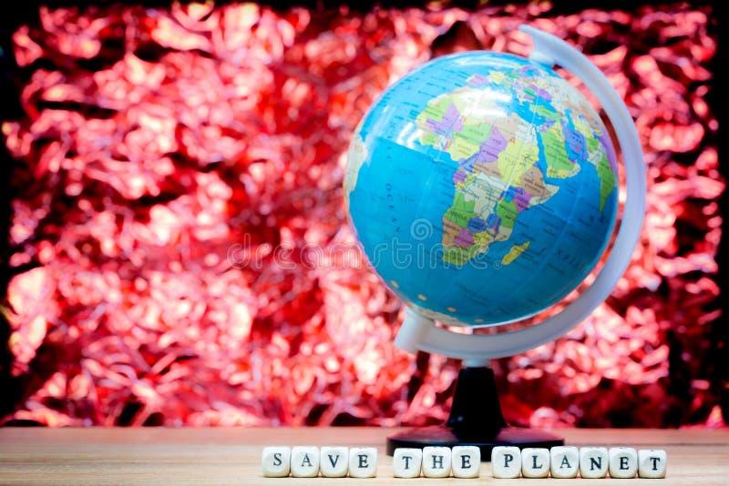 Blå planet på röd bakgrund med ord arkivfoton
