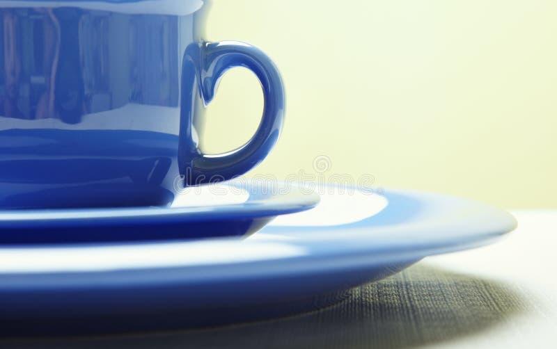 blå plattateacup royaltyfria foton