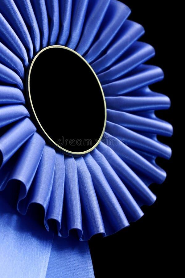 blå rosette royaltyfria bilder