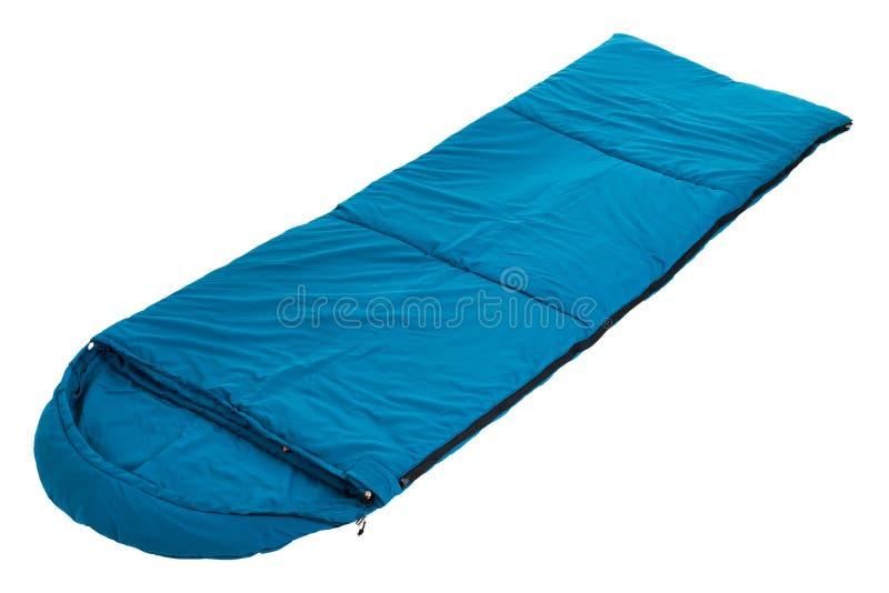 Blå sovsäck som isoleras på en vit bakgrund royaltyfria foton