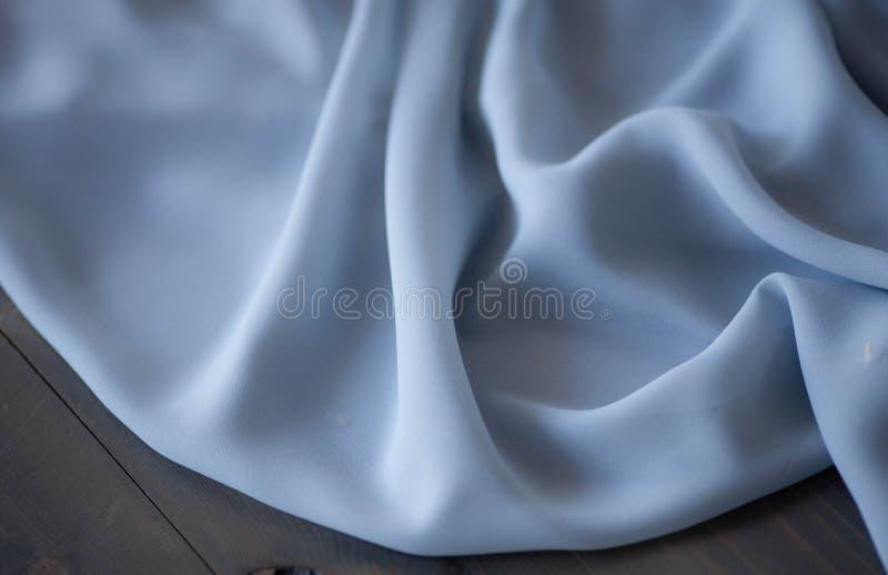 Blå tygtexturbakgrund, krabbt tyg arkivfoto