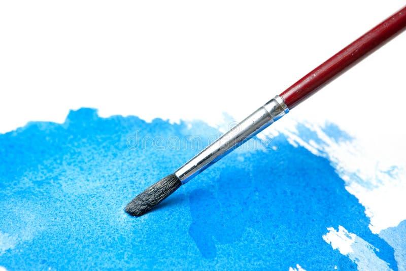 blå vattenfärg för borstefärgwash royaltyfri bild