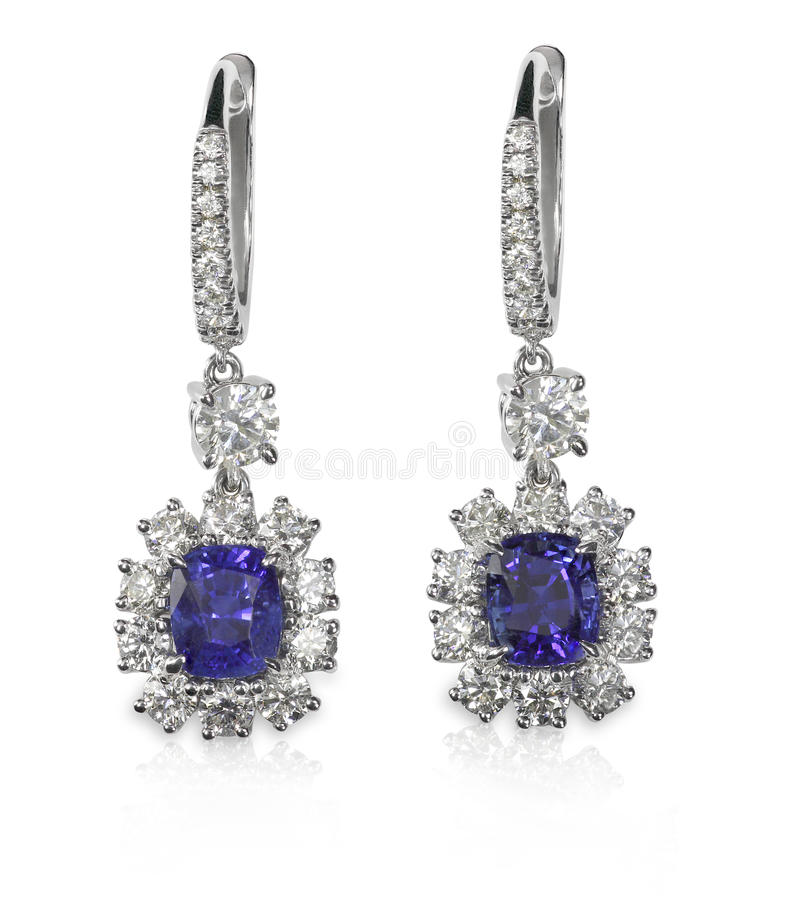 Blåa gemstone- och diamantörhängen royaltyfri foto