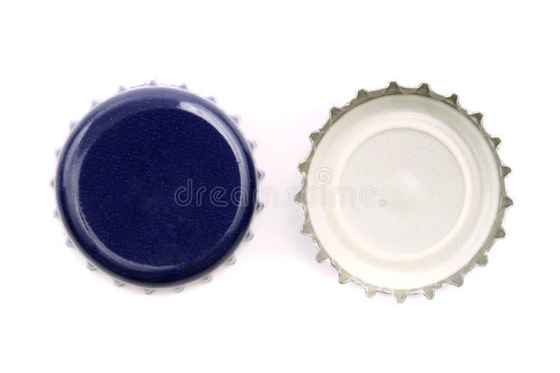 Blåa kapsyler royaltyfri fotografi