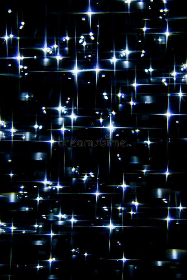Blåa stjärnor på himlen royaltyfria bilder
