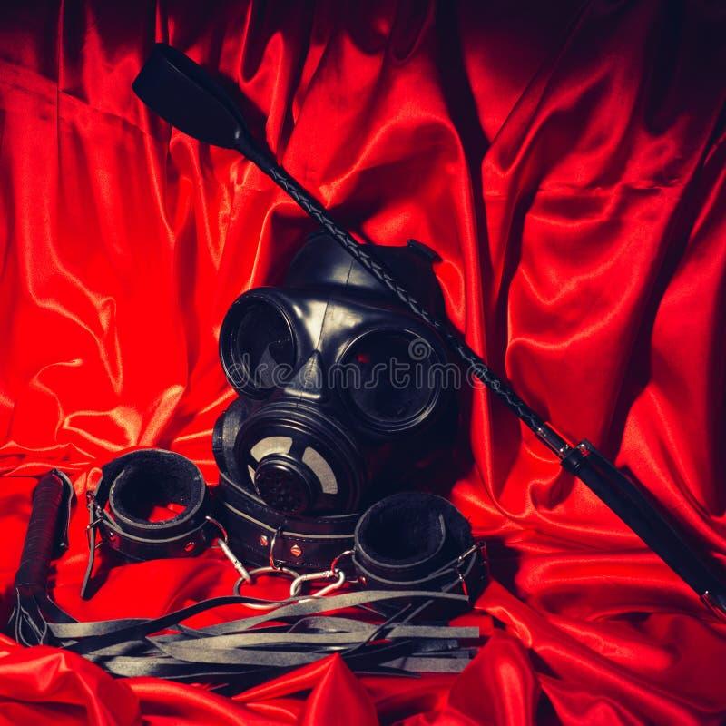 Blåd bild av bdsm-utrustning Bondage, kinky vuxen sex, kink och BDSM livsstilskoncept royaltyfria bilder