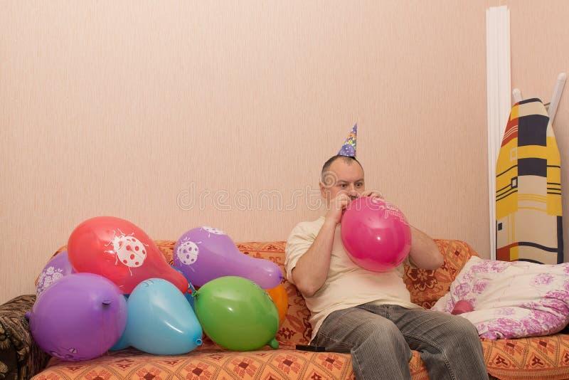 Blåser upp ballongmannen royaltyfria foton