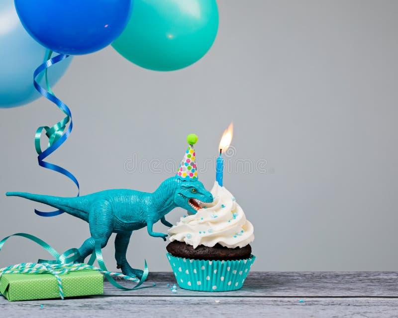 Blått dinosauriefödelsedagparti royaltyfri fotografi