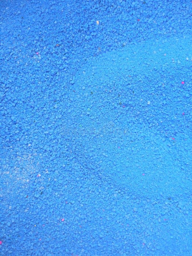 Blått färgpulver royaltyfri fotografi