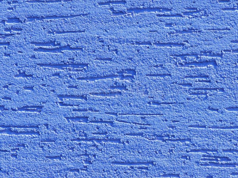 Blått facade-gips Dekorativ bakgrund för monolitiskt gips Papper med enkelt lager, skrapat av cementplast Sand-exter arkivfoto