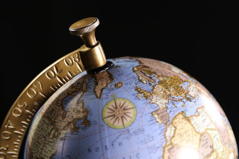 Blått och guld- jordklot för lyx och att föreställa internationellt lopp eller affär arkivbilder