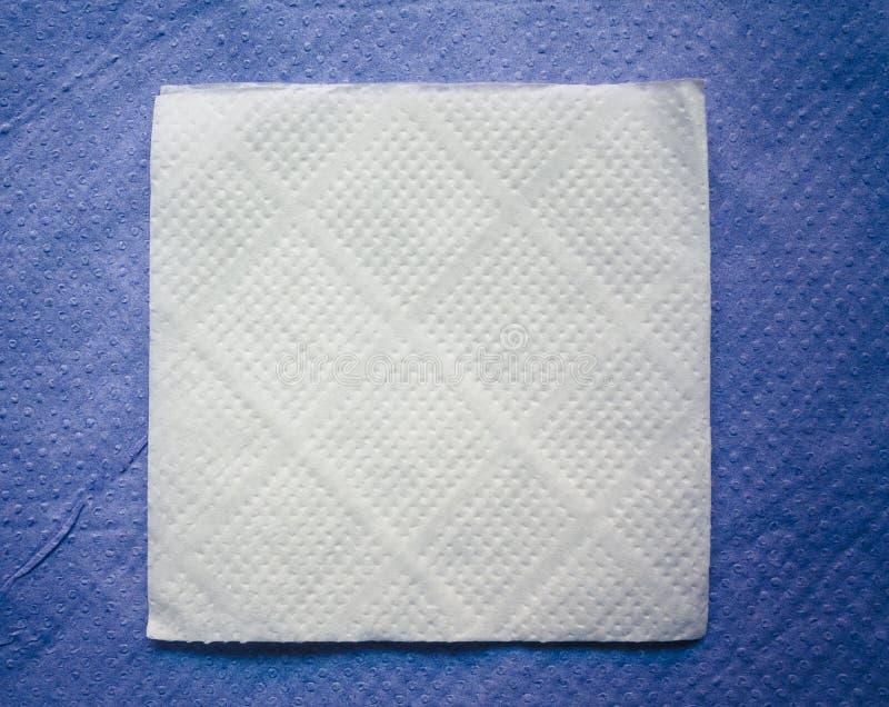 blått servettpapper för bakgrund royaltyfri bild