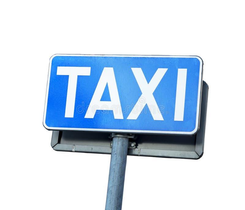 Blått taxigatatecken som isoleras på vit fotografering för bildbyråer