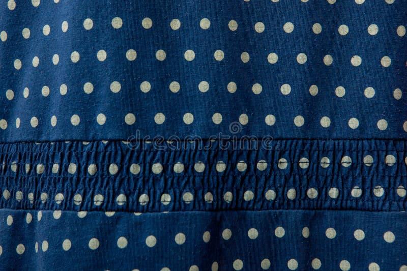 Blått tyg för bakgrundsbomull med huvudmodellen arkivfoton