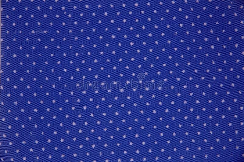 Blått tyg med vita prickar royaltyfri foto