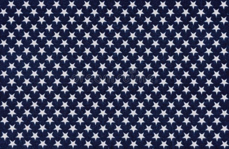 Blått tyg med vita stjärnor arkivfoto