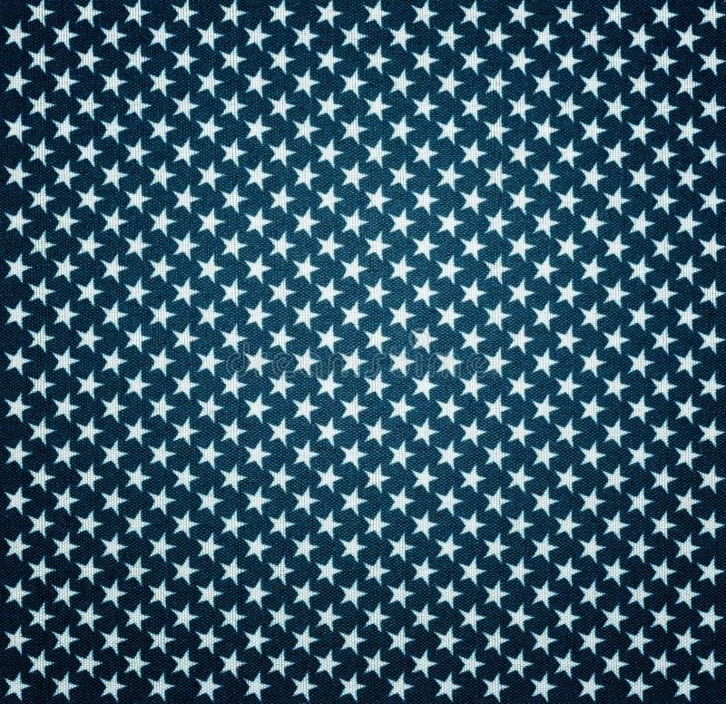 Blått tyg med vita stjärnor med karaktärsteckningeffekt fotografering för bildbyråer