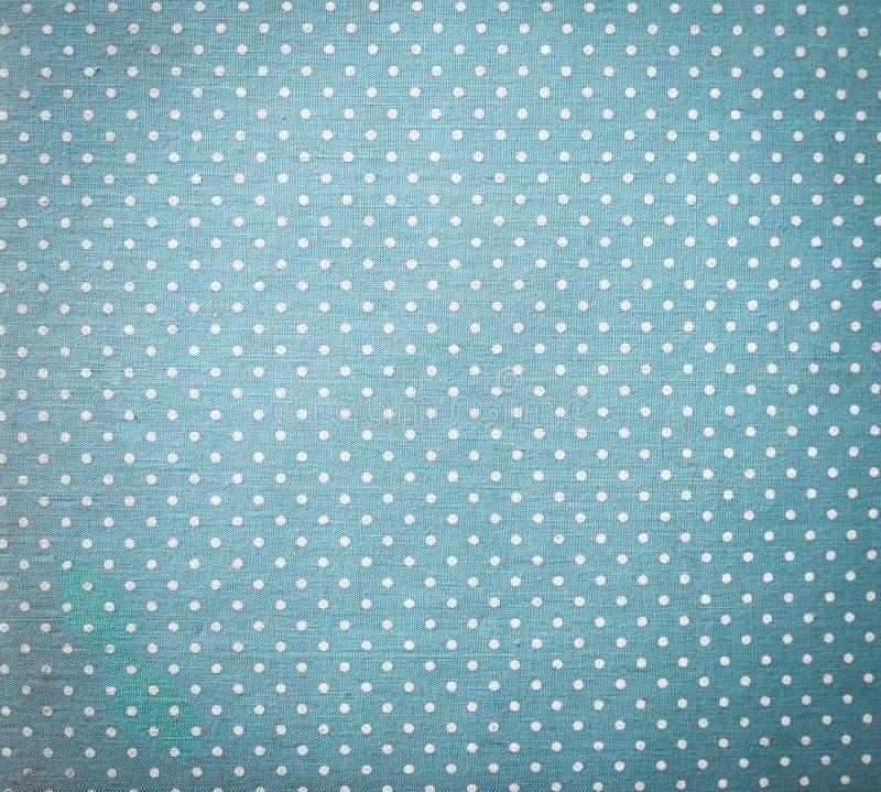 Blått tyg och vita mycket små prickar royaltyfria bilder