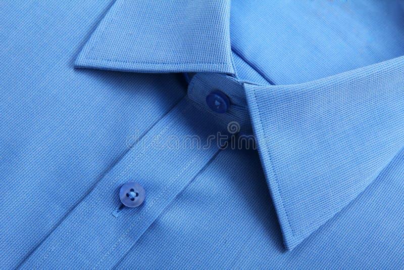 Blåttaffärsskjorta. royaltyfri bild