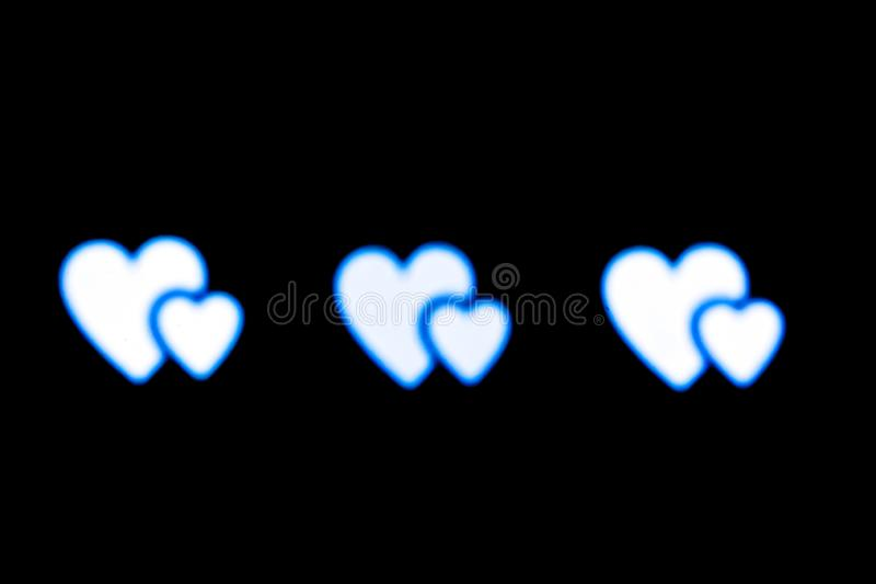 Blåvitt foto för bakgrund för hjärtabokehsvart arkivfoton