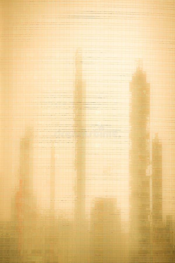 Blacground arancio degli edifici per uffici riflessi sul grattacielo di vetro fotografia stock