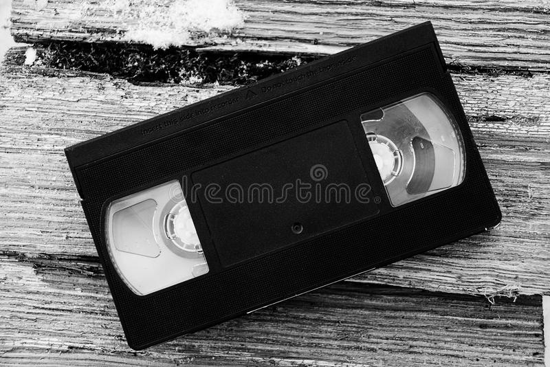 Black video cassette on the pieces of tree royalty free stock photo