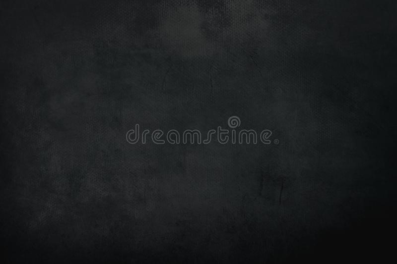 Old black grungy painting background. Black abstract background or texture stock images