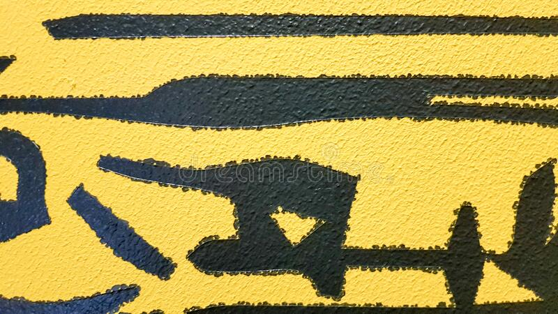 Black abstract paint splashes dripping on a bright yellow background. Black paint splashes on a yellow background. concept of art. Ideas. Paint brush texture royalty free stock image