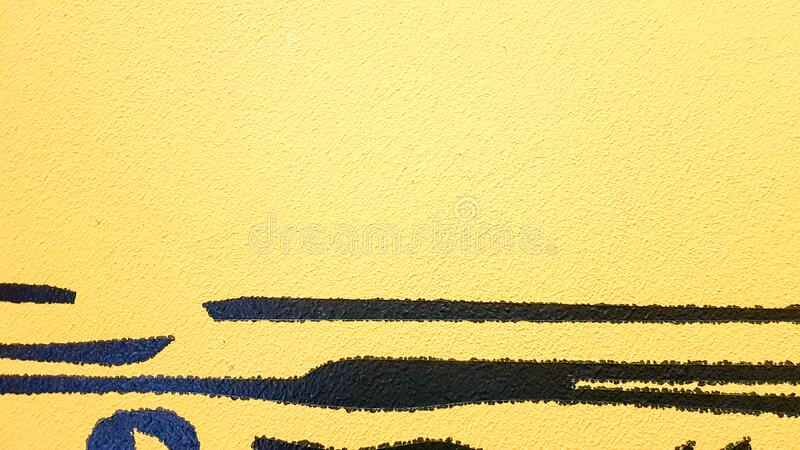 Black abstract paint splashes dripping on a bright yellow background. Black paint splashes on a yellow background. concept of art. Ideas. Paint brush texture stock photo