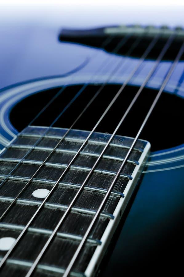 Black acoustic guitar. Detail close-up stock photo