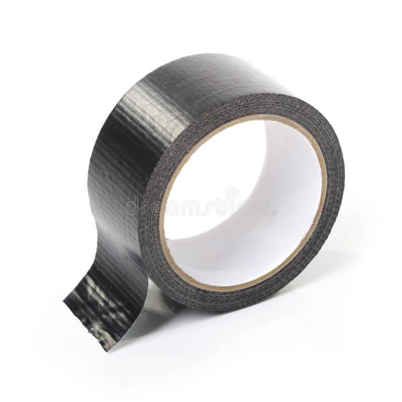 Black adhesive tape. On white background stock photography