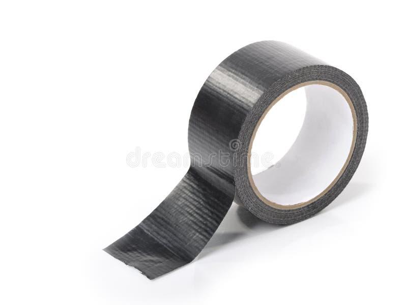 Black adhesive tape. Isolated on white background stock image