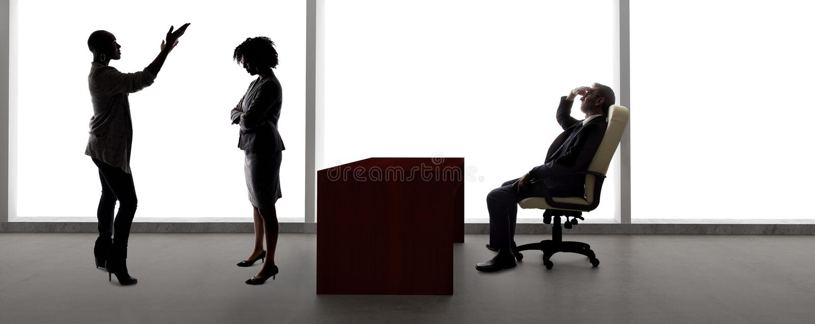 Silhouettes of Female Actors in an Audition with a Casting Director royalty free stock photo
