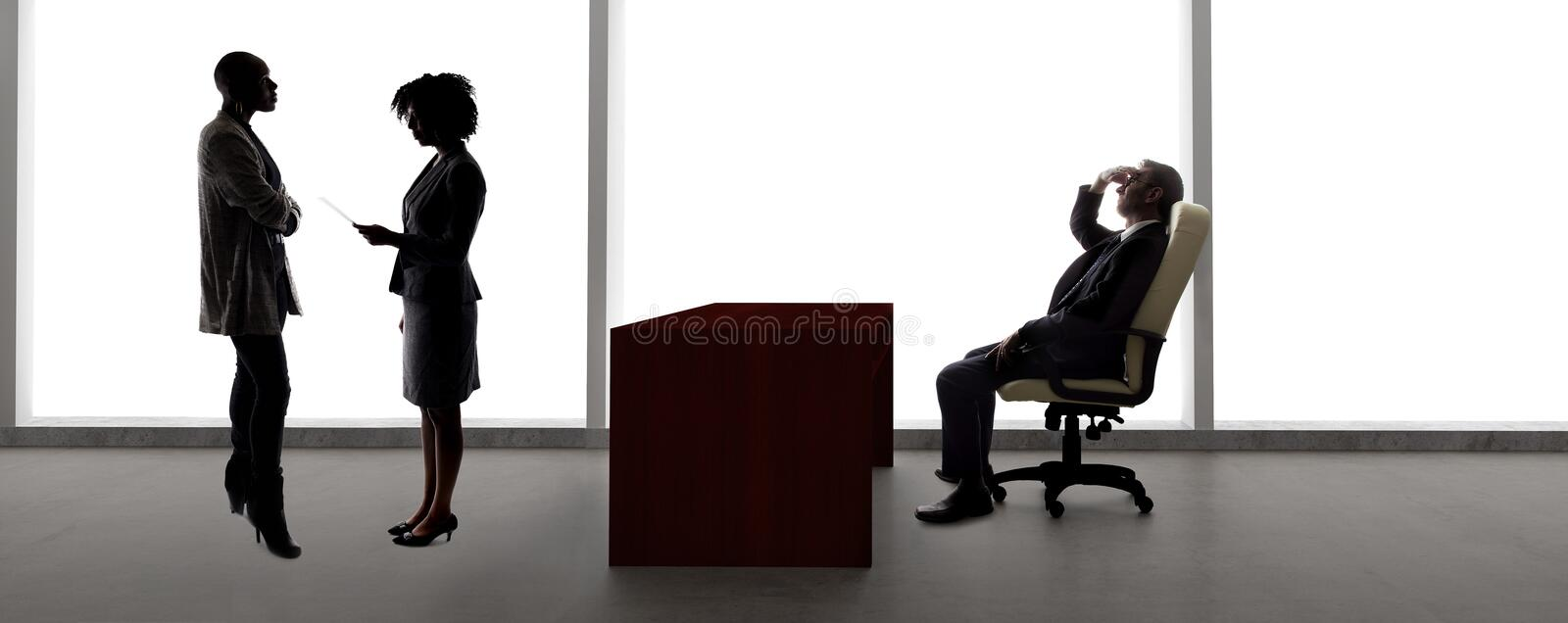 Silhouettes of Female Actors in an Audition with a Casting Director royalty free stock images