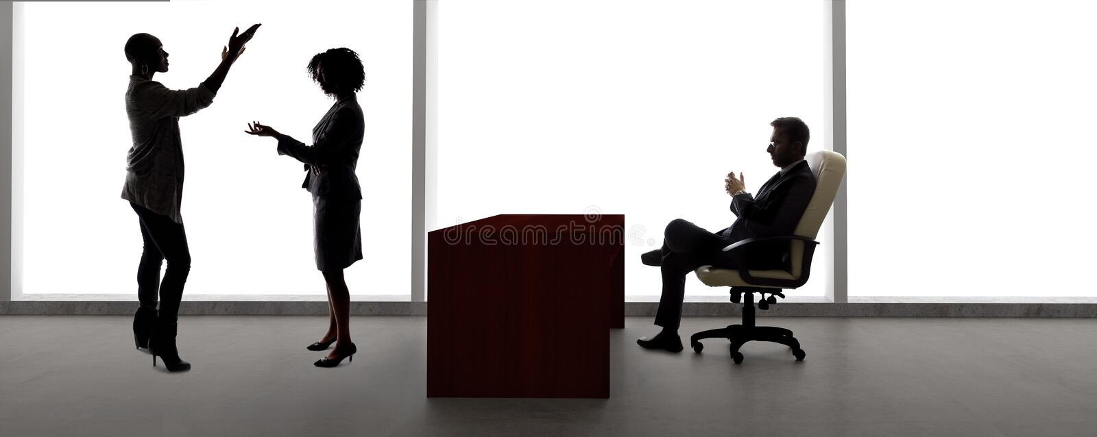 Silhouettes of Female Actors in an Audition with a Casting Director royalty free stock photography