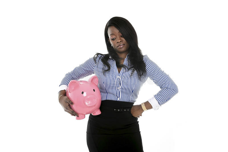 Black African American business woman holding huge pink piggybank stock images